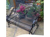 Wrought iron garden glider bench