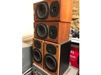 Tannoy r1 revolution surround sound speakers and a centre speaker.