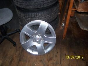 Pontiac G6 Tires On Rims WIth Hubcaps