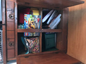 Cabinet with drawer and shelf.