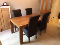 Next rustic hardwood table with 4 high back leather chairs (very good condition)