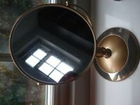 Gold mirror, with magnifying on one side