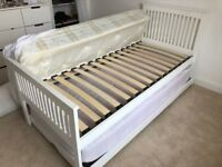 White single bed with headboard, trundle & 2 mattresses. Used