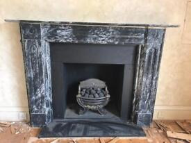 Solid black marble fireplace surround