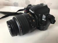 Nikon D3000 DSLR Camera with Lens and Bag