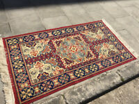 Rug in good condition . Mostly reds and blue colours . Size L 65in D 35in .