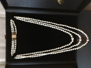***RARE TRIPLE STRAND, CASCADING PEARL NECKLACE***
