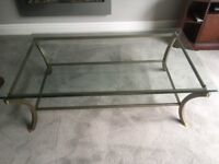 Glass top coffee table with lower glass shelf in metal frame