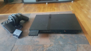 Ps2 Slim and 18 games