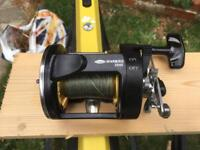Heavy duty boat fishing reel loaded with 40lb braid ready to fish with good condition