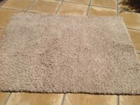 BISCUIT COLOURED LONG PILE RUG
