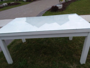 white table with glass top piece that sits on solid wood