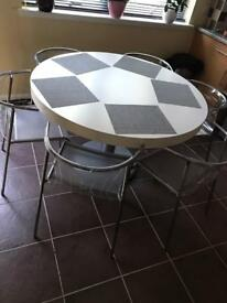 Dinning round table and 6 ikea elmer chrome chairs