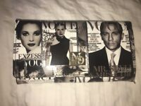Vogue magazine printed black and white purse. Excellent condition, unused