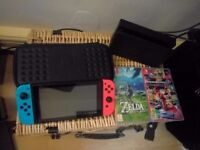 Nintendo Switch Red/Blue Neon with Zelda: Botw, Mario Kart 8, 64gb SD card and official case.