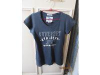 2 Superdry t-shirts. Navy size medium. Orange size Large. Ladies.