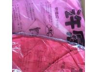 Pink and red Chinese lanterns with wax