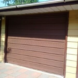 9x7 steel garage doors with hardware (325.00 for the pair)