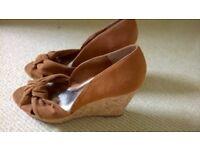 Pair of unworn suede effect wedge heel open toed shoes