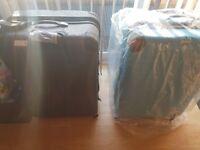2 Brand New Suitcases