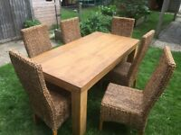 "Solid Oak Table and 6 Chairs. L: 5' 10"" W: 2' 11.5"" H 2' 10"""