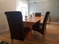 Large 6 seater dining table 1800mm long X 970mm wide x 750mm high + 6 brown leather effect chairs.