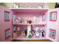 Dolls house complete with furniture and little folk!