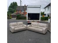3 and 2 seater sofa in a grey coloured leather