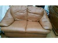 Small tan sofa