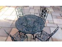 "Garden table green aluminium (wont rust) 42"" diam & 4 matching chairs near perfect condition."