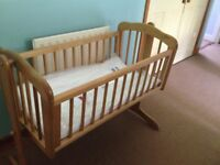 Rocking babies cradle crib with unused new, wrapped mattress