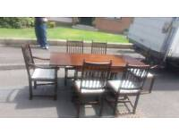 Dark oak extendable table with 6 chairs 2 carvers