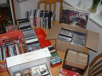 A collection of over 200 records cds dvds cassettes & video films