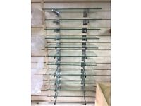 Second hand glass shelves with slatwall brackets. Retail shop shelving. Used excellent condition