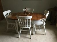 Dining/kitchen table and 4 chairs. Solid wood. Buyer collects