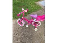 Bargain pink girl bike with stabilisers wheels and toys basket