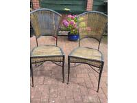 Wrought iron and cane chairs