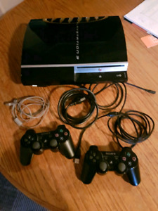 PLAYSTATION 3 WITH TWO CONTROLLERS AND GAMES