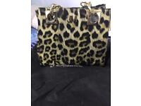 Brand new Julienne Macdonald hand bag. With bag protector