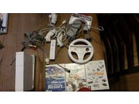 Nintendo WII Excellent condition mutliple accessories and three games