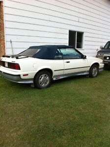 Z24 convertible 89 Z24, 2.8 lt. white with navy top. Navy interi