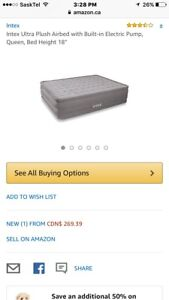 Queen sized air bed with built in electric inflation pump