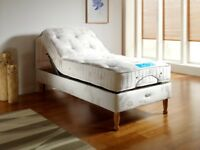 NEW, UNUSED. EX DEMO MODEL. 2ft6 single electric adjustable bed base & mattress.divan set