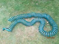 30 metre (100') super coil garden hose with spray gun