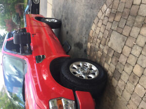 """Mint f250 oem 20"""" rims and tires"""