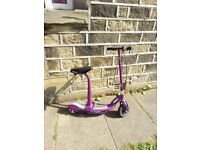 Purple, fully working electric scooter and charger.