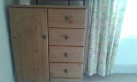 Chest of drawers with small hanging space.