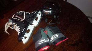 Kids skates size 12 gloves and hockey helmet