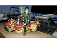 Hand made plaster figure and motorcycle