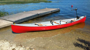Canoe with gear and electric motor
